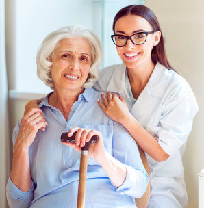 smiling and cheerful senior woman with her caregiver