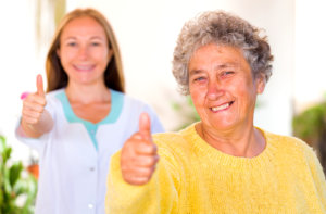 patient and caregiver doing thumbs up