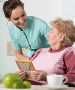 young pretty nurse and elderly woman